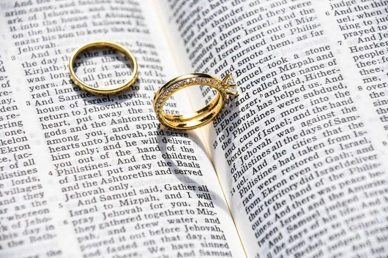 Wedding ring on paper Piqsels