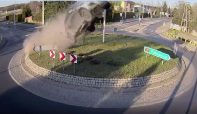 Car hits roundabout and goes flying