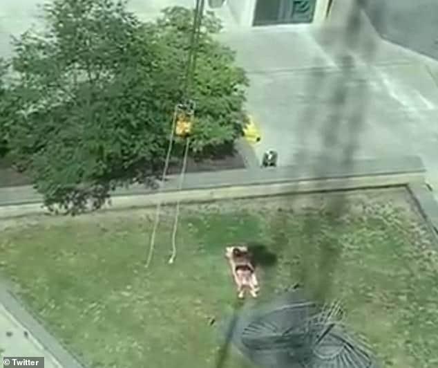 Crane driver hilariously follows sunbather to block his sun